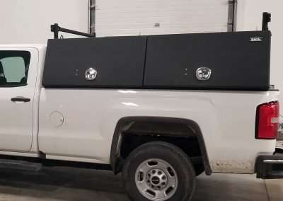 Closed Smooth Black X-Pro High Side Pack in a White GMC Pickup